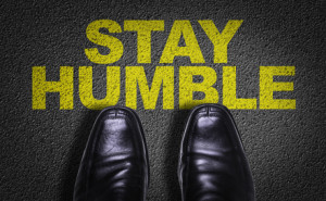 Top View of Business Shoes on the floor with the text: Stay Humble