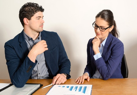 two young business people discussing